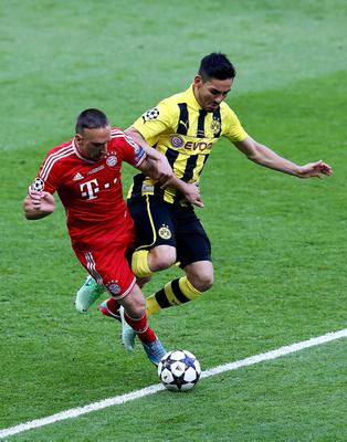 LONDON, ENGLAND - MAY 25:  Franck Ribery of Bayern Muenchen (L) in action with Ilkay Gundogan of Borussia Dortmund during the UEFA Champions League final match between Borussia Dortmund and FC Bayern Muenchen at Wembley Stadium on May 25, 2013 in London, United Kingdom.  (Photo by Martin Rose/Getty Images)