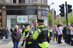 Man is restrained by PSNI officers