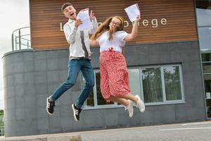 Pacemaker Press Intl 150819  Pupils at Lagan College celebrate their A Level results today.  This year was Lagan's best year ever with students receiving a 10% rise in grades. Pictured is Head Girl & Head Boy Kate Brown (3 A's), Billy Blackwood (2 A*, 1 A) celebrating their results . Photo David McCormick/Pacemaker Press