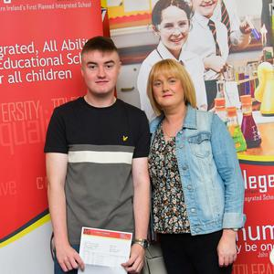 Pacemaker Press Intl 150819  Pupils at Lagan College celebrate their A Level results today.  This year was LaganÕs best year ever with students receiving a 10% rise in grades. Pictured is Eoin Burns and Mum who got  A*, C, C . Photo David McCormick/Pacemaker Press