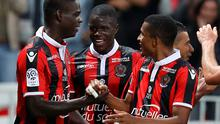 Nice's Italian forward Mario Balotelli (L) celebrates with teammates after scoring a goal during the French L1 football match between Nice (OGCN) and Monaco (ASM) on September 21, 2016 at Allianz Riviera Stadium in Nice, southeastern France. / AFP PHOTO / VALERY HACHEVALERY HACHE/AFP/Getty Images