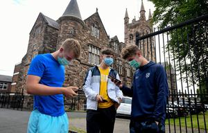Pupils wearing masks, receiving their A Level results. Photo By Justin Kernoghan