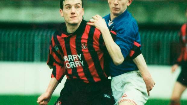 Striped for battle: Glenn in action for the Crues against boyhood favourites Linfield
