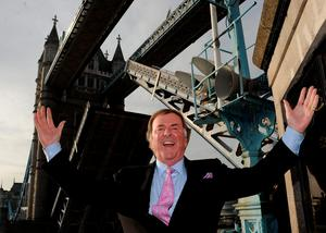 Sir Terry Wogan celebrating being given the Freedom of the City of London by single-handedly raising Tower Bridge