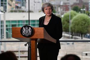 "Prime Minister Theresa May during her speech at the Waterfront Hall in Belfast where she urged the European Union to ""evolve"" its position on Brexit and not fall back on ""unworkable"" ideas. PRESS ASSOCIATION Photo. Picture date: Friday July 20, 2018. See PA story POLITICS Brexit. Photo credit should read: Charles McQuillan/PA Wire"