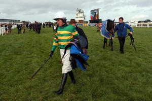 Jockey Tony McCoy makes his way in after the Bathwick Tyres Plymouth Novices´ Hurdle at Exeter Racecourse, Exeter. PRESS ASSOCIATION Photo. Picture date: Tuesday November 5, 2013. See PA story RACING Exeter. Photo credit should read: David Davies/PA Wire