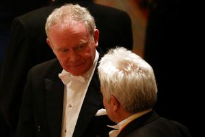 Martin McGuinness (left), the Deputy First Minister of Northern Ireland attends a State Banquet in honour of the President of Ireland Michael D. Higgins at Windsor Castle during the first State visit to the UK by an Irish President.