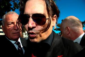 US actor Johnny Depp arrives at a court in the Gold Coast on April 18, 2016.  Depp and Heard arrived at an Australian court April 18 over Heard's alleged illegal importation of their two Yorkshire terrier dogs Boo and Pistol into the country in a private jet in 2015, as Depp was in Australia for the filming of the latest Pirates of the Carribean movie.    / AFP PHOTO / Patrick HAMILTONPATRICK HAMILTON/AFP/Getty Images