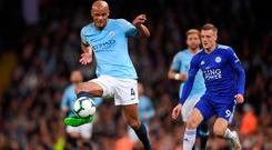Under control: Vincent Kompany keeps things ticking over for City