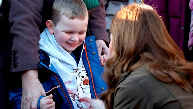 The Duchess of Cambridge talks to a young boy at the Ark Open Farm, at Newtownards, near Belfast, where she also met with parents and grandparents to discuss their experiences of raising young children for her Early Childhood survey. PA Photo. Picture date: Wednesday February 12, 2020. See PA story ROYAL Kate. Photo credit should read: Peter Byrne/PA Wire