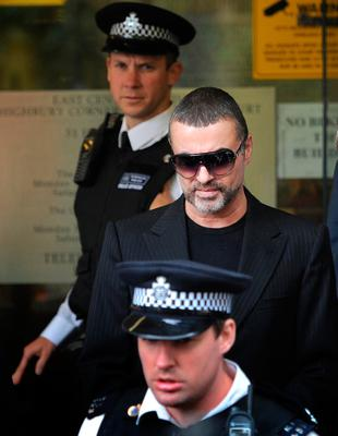 George Michael leaving Highbury Corner Magistrates' Court in north London, after he appeared charged with driving under the influence of drugs after his car crashed into a high street shop.