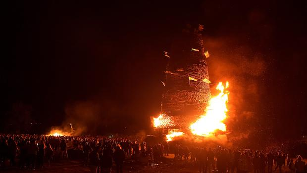 Hundreds of people gather for the 11th night bonfire as it is set alight at the New Mossley housing estate on July 12, 2015 in Belfast, Northern Ireland. New Mossley is widely recognised as the largest bonfire in the province. (Photo by Charles McQuillan/Getty Images)