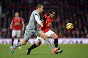 Manchester United's Radamel Falcao (right) and Newcastle United's Steven Taylor battle for the ball during the Barclays Premier League match at Old Trafford, Manchester. Rickett/PA Wire.