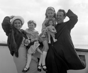 Bruce Forsyth with his wife, Penny, and their two daughters, Debbie (right), 6, and Julie, 3, who will celebrate her fourth birthday at sea, as they left Southampton aboard the liner Pendennis Castle for South Africa. PA Wire