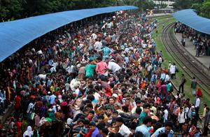 Bangladeshi Muslims sit on the roof of an already packed train for homebound ahead of Eid al-Fitr as others wait at a railway station in Dhaka, Bangladesh, Thursday, Aug. 8, 2013. The mass exodus out of the capital and other major cities in the country is underway as millions are heading back to their home towns to celebrate Eid al-Fitr holiday which marks the end of the holy fasting month of Ramadan. (AP Photo/A.M. Ahad)