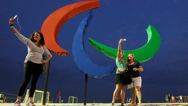 RIO DE JANEIRO, BRAZIL - SEPTEMBER 05:  People take photos in front of the Paralympic symbol, Agitos, on Copacabana beach ahead of the Rio 2016 Paralympic Games on September 5, 2016 in Rio de Janeiro, Brazil.  (Photo by Mario Tama/Getty Images)
