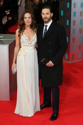LONDON, ENGLAND - FEBRUARY 16:  Kelly Marcel and actor Tom Hardy attend the EE British Academy Film Awards 2014 at The Royal Opera House on February 16, 2014 in London, England.  (Photo by Chris Jackson/Getty Images)