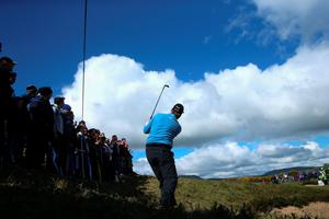 NEWCASTLE, NORTHERN IRELAND - MAY 29:  Ernie Els of South Africa hits his 2nd shot on the 16th hole during the Second Round of the Dubai Duty Free Irish Open Hosted by the Rory Foundation at Royal County Down Golf Club on May 29, 2015 in Newcastle, Northern Ireland.  (Photo by Andrew Redington/Getty Images)
