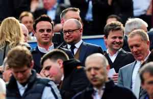 NEWCASTLE UPON TYNE, ENGLAND - MAY 19: Newcastle fans Ant McPartlin and Declan Donnelly look on during the Barclays Premier League match between Newcastle United and Arsenal at St James' Park on May 19, 2013 in Newcastle upon Tyne, England. (Photo by Stu Forster/Getty Images)
