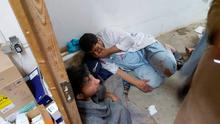 FILE - In this Oct. 3, 2015 file photo, injured Doctors Without Borders staff are seen near their hospital after it was hit by a U.S. airstrike. Days before the Oct. 3 U.S. air attack on a hospital in Afghanistan, American special operations analysts were gathering intelligence on the facility  which they knew was a protected medical site  because they believed it was being used by a Pakistani operative to coordinate Taliban activity, The Associated Press has learned.  (M?decins Sans Fronti?res via AP, File)