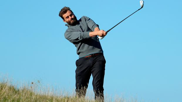 KINGSBARNS, AK - OCTOBER 05:  Actor Jamie Dornan plays during a practice round at the Alfred Dunhill Links Championship at Kingsbarns Golf Links golf course on October 5, 2016 in St Andrews, Scotland.  (Photo by Richard Heathcote/Getty Images)