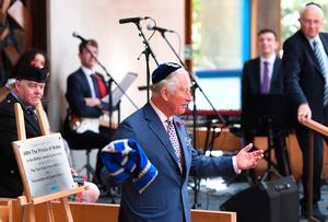 The Prince of Wales unveils a plaque during a visit to Belfast Synagogue on the second day of the Royal couple's visit to Northern Ireland. Joe Giddens/PA Wire