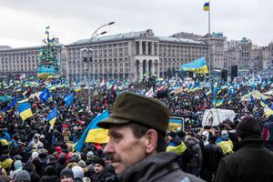 KIEV, UKRAINE - DECEMBER 8: Anti-government protesters hold a large rally on Independence Square on December 8, 2013 in Kiev, Ukraine. Thousands of people have been protesting against the government since a decision by Ukrainian president Viktor Yanukovych to suspend a trade and partnership agreement with the European Union in favor of incentives from Russia. (Photo by Brendan Hoffman/Getty Images)