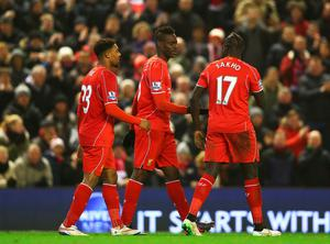 Mario Balotelli (C) of Liverpool celebrates his goal with team mates during the Barclays Premier League match between Liverpool and Tottenham Hotspur at Anfield on February 10, 2015 in Liverpool, England.  (Photo by Clive Brunskill/Getty Images)