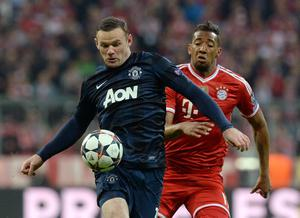 Manchester United's Wayne Rooney (left) and Bayern Munich's Jerome Boateng battle for the ball during the Champions League, Quarter Final, Second Leg at the Allianz Arena, Munich, Germany.