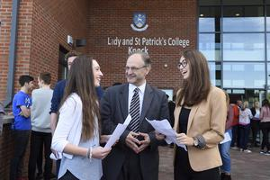 Education Minister, Peter Weir, pictured at a visit to Our Lady's and St Patrick's College with pupils, Eimear Rogers (left) and Clare Dempsey. Picture: Michael Cooper