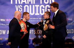 Carl Frampton (second left) and Scott Quigg (second right) are restrained by promoters Barry McGuigan and Eddie Hearn go head to head after a press conference at the Radisson Blu Hotel, Manchester. Simon Cooper/PA Wire.