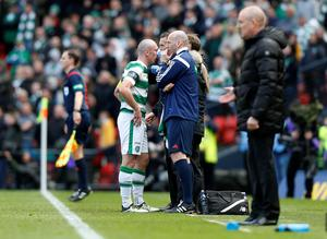 Celtic's Scott Brown gets treatment on the sideline during the William Hill Scottish Cup semi-final match at Hampden Park, Glasgow. PRESS ASSOCIATION Photo. Picture date: Sunday April 17, 2016. See PA story SOCCER Rangers. Photo credit should read: Danny Lawson/PA Wire. EDITORIAL USE ONLY