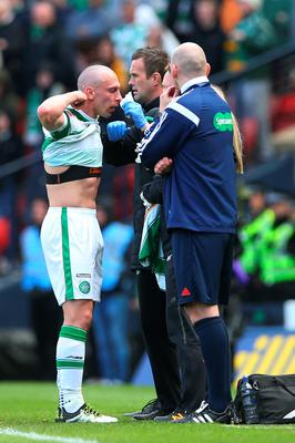 GLASGOW, SCOTLAND - APRIL 17:   Scott Brown of Celtic receives medical attention during the William Hill Scottish Cup semi final between Rangers and Celtic at Hampden Park on April 17, 2016 in Glasgow, Scotland.  (Photo by Ian MacNicol/Getty Images)