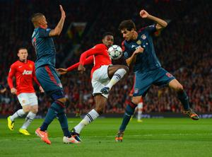 MANCHESTER, ENGLAND - APRIL 01:  Danny Welbeck of Manchester United controls the ball under pressure from Jerome Boateng and Javi Martinez of Bayern Muenchen during the UEFA Champions League Quarter Final first leg match between Manchester United and FC Bayern Muenchen at Old Trafford on April 1, 2014 in Manchester, England.  (Photo by Michael Regan/Bongarts/Getty Images)