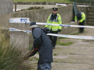 Garda search a farmhouse in Co Monaghan after Paul Quinn's savage beating.