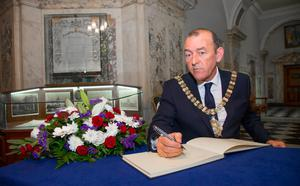Picture - Kevin Scott   Belfast , UK - NOVEMBER 16 : Lord Mayor Arder Carson opens the Book of Condolence opened for French victims at Belfast City Hall in Belfast, Northern Ireland on November 16 (Photo by Kevin Scott )