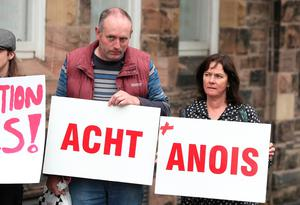 Protestors call for the Irish language to be recognised outside the Crescent Arts Centre in Belfast, Northern Ireland, ahead of the arrival of Prime Minister Theresa May. PRESS ASSOCIATION Photo. Picture date: Friday July 20, 2018. See PA story POLITICS Brexit. Photo credit should read: Brian Lawless/PA Wire