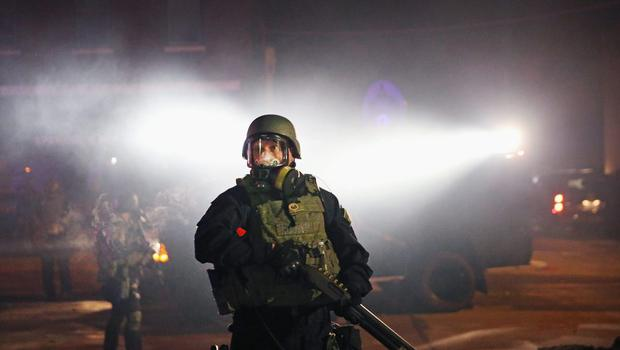 Police confront demonstrators during a protest on November 25, 2014 in Ferguson, Missouri.  (Photo by Scott Olson/Getty Images)