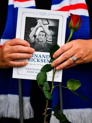 GLASGOW, SCOTLAND - SEPTEMBER 25: Fans pay their respects to former Rangers player Fernando Ricksen as his funeral cortege makes it's way past Ibrox Stadium, along Paisley Road West on September 25, 2019 in Glasgow, Scotland. The Dutch international died last week at the age of 43 after battling motor neurone disease since 2013. (Photo by Jeff J Mitchell/Getty Images)