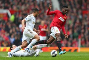 MANCHESTER, ENGLAND - MAY 12:  Danny Welbeck of Manchester United hurdles the tackle of Leon Britton of Swansea City during the Barclays Premier League match between Manchester United and Swansea City at Old Trafford on May 12, 2013 in Manchester, England.  (Photo by Alex Livesey/Getty Images)