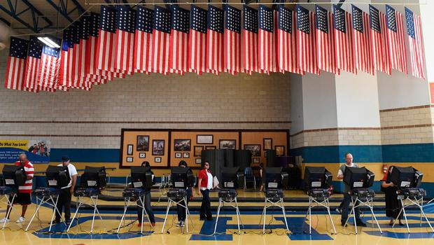 NORTH LAS VEGAS, NV - NOVEMBER 08:  Voters cast their ballots at voting machines at Cheyenne High School on Election Day on November 8, 2016 in North Las Vegas, Nevada. Americans across the nation are picking their choice for the next president of the United States.  (Photo by Ethan Miller/Getty Images)