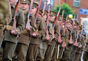 Men in period costume parade as the main 12th July parade moves off from Carlisle circus in Belfast, on July 12, 2016. 12th July is the main marching day in the Orange Order calendar. The parades mark the 326th anniversary of King William III's victory at the Battle of the Boyne in 1690. / AFP PHOTO / PAUL FAITHPAUL FAITH/AFP/Getty Images