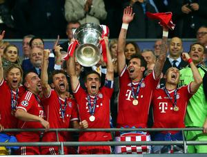 LONDON, ENGLAND - MAY 25:  Captain Philipp Lahm of Bayern Muenchen lifts the trophy after winning the UEFA Champions League final match against Borussia Dortmund at Wembley Stadium on May 25, 2013 in London, United Kingdom.  (Photo by Alex Grimm/Getty Images)