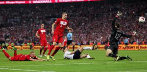 England's Steven Gerrard scores his side's second goal of the game during the FIFA 2014 World Cup Qualifying, Group H match at Wembley Stadium, London.