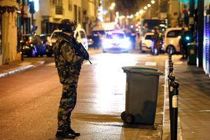 Soldiers secure the area near La Belle Equipe, rue de Charonne, at the site of an attack on Paris on November 14, 2015 after a series of gun attacks occurred across Paris as well as explosions outside the national stadium where France was hosting Germany. More than 100 people were killed in a mass hostage-taking at a Paris concert hall and many more were feared dead in a series of bombings and shootings, as France declared a national state of emergency.  AFP PHOTO / PIERRE CONSTANTPIERRE CONSTANT/AFP/Getty Images
