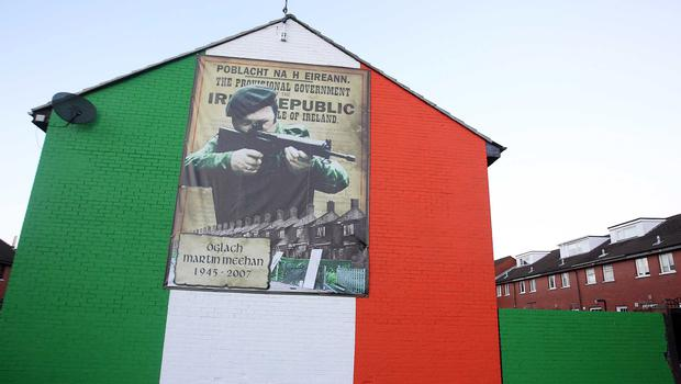 Murals down the years ... republican mural depicting former north Belfast IRA man Martin Meehan is revealed in the Ardoyne area of Belfast.