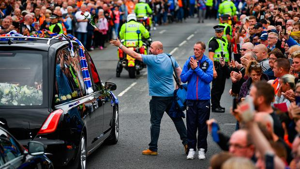 GLASGOW, SCOTLAND - SEPTEMBER 25: Fans pay their respects to former Rangers player Fernando Ricksen as his funeral cortege makes its way past Ibrox Stadium, along Paisley Road West on September 25, 2019 in Glasgow, Scotland. The Dutch international died last week at the age of 43 after battling motor neurone disease since 2013. (Photo by Jeff J Mitchell/Getty Images)