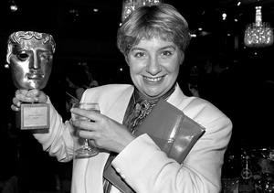"""Victoria Wood with her BAFTA Award for The Best Light Entertainment Performance for """"Victoria Wood As Seen on TV"""". Photo credit: PA Wire"""