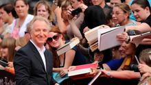 2011: Alan Rickman signs autographs as he arrives for the North American premiere of Harry Potter and the Deathly Hallows  Part 2 at Lincoln Center in New York.    AFP PHOTO / STAN HONDASTAN HONDA/AFP/Getty Images