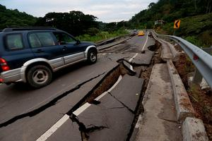 A vehicle rolls on a cracked route after a 7.8-magnitude quake in Chone, Ecuador on April 17, 2016.  At least 246 people were killed when a powerful earthquake struck Ecuador, destroying buildings and a bridge and sending terrified residents scrambling from their homes, authorities said Sunday. / AFP PHOTO / JUAN CEVALLOSJUAN CEVALLOS/AFP/Getty Images